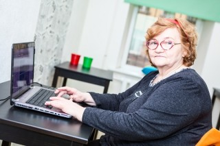 http://www.dreamstime.com/royalty-free-stock-images-retirement-age-woman-sitting-table-laptop-looking-camera-image40783039